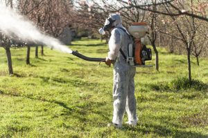 Spraying pesticides in a bio suit